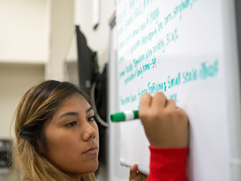 Crespin writes on board | W.K. Kellogg Foundation